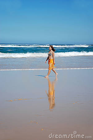 Beach walk woman