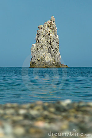Beach, water, rock in sea