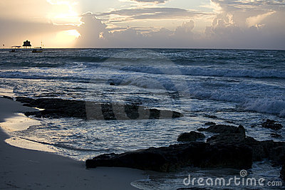 Beach and waves at sunrise on Riviera Maya