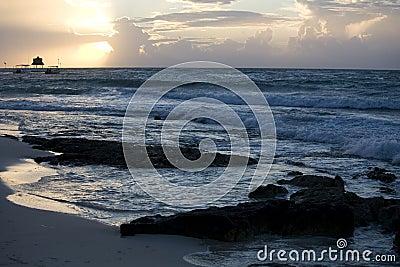 Beach and waves at sunrise on Riviera Maya