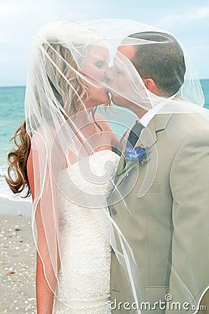 Beach Wedding: Bride and Groom Kiss