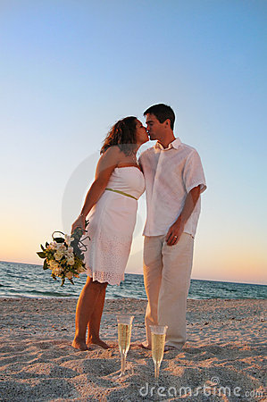 Beach wedding couple kiss