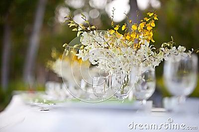 Beach wedding decor table setting and flowers