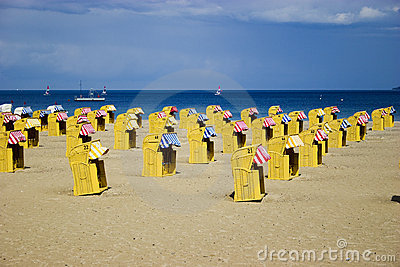 Beach wicker chairs near sea