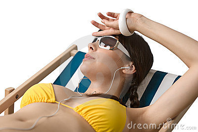 Beach - Woman with ear buds relax in bikini