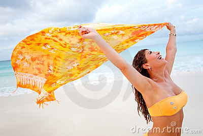Beach woman feeling the wind