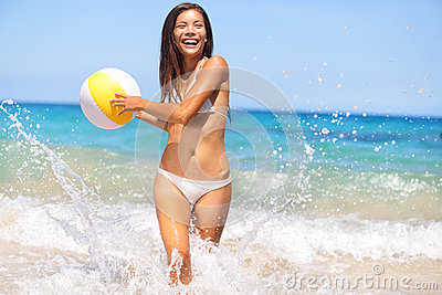 Beach woman having fun laughing enjoying sun