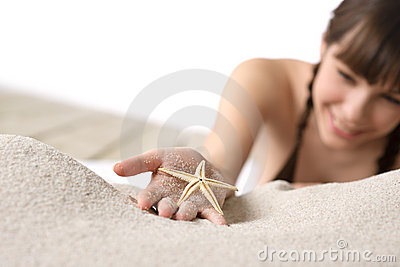 Beach - woman holding starfish on sand