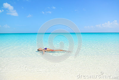 beach woman swimming ocean relaxing enjoying sun bathing peaceful blue water sexy female adult floating meditating sea 61430031