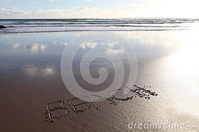 Beach word written in sand