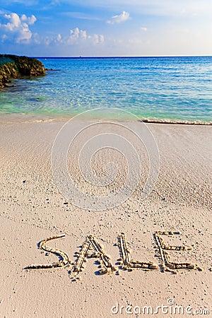 On a beach it is written SALE