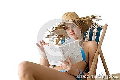 Beach - Young woman relax with book in bikini