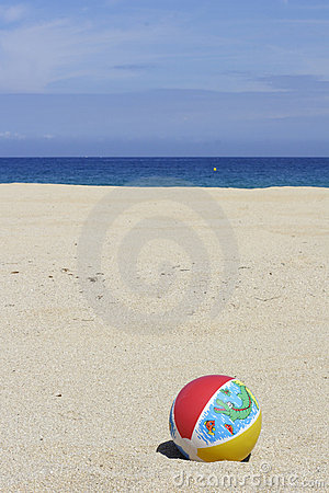 Beachball on empty sandy beach