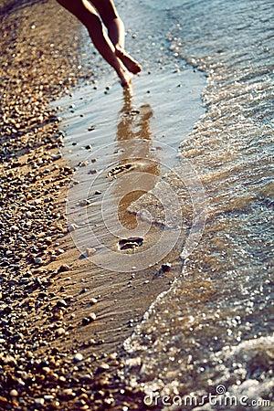 Beachwalk with footprints