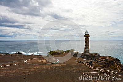 Beacon Capelinhos on the shore of Atlantic ocean, island Faial,