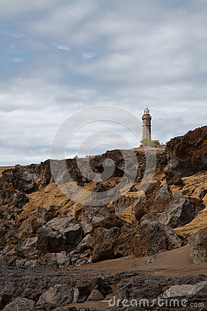 Beacon Capelinhos on the shore island Faial, Azores