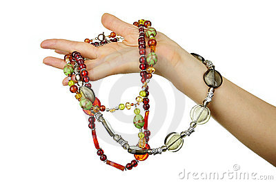 Beaded jewels in woman hand