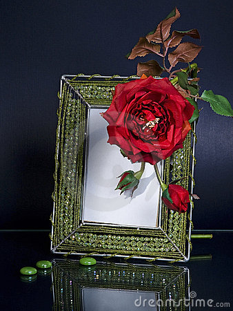 Beaded photoframe and a red flower on black