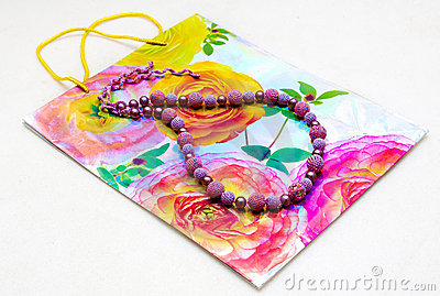 Beads on a background of paper bag