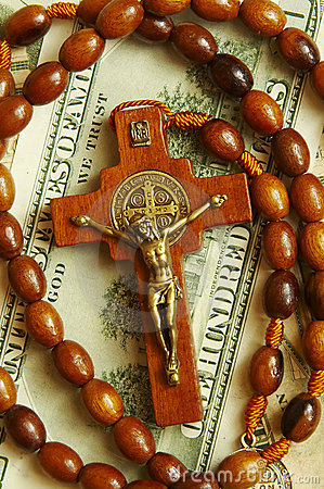 Free Beads With Cross On Dollars Royalty Free Stock Photo - 4934215