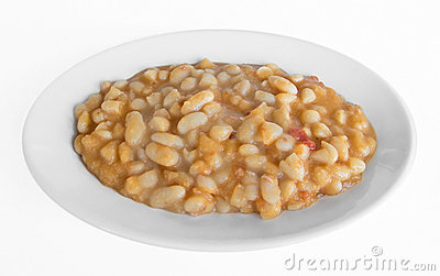 Bean soup on white dish.