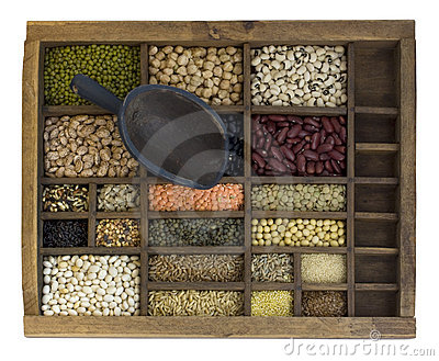 Beans, grain, sseeds in typesetter case with scoop