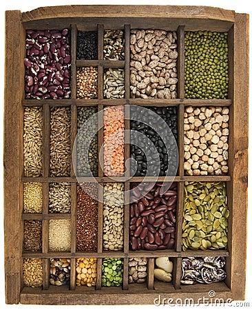 Beans, grains, seeds in vintage typesetter box