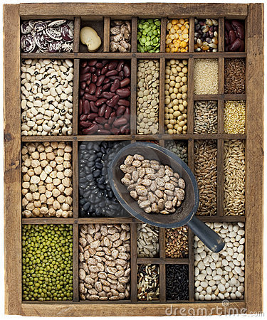 Beans and grains in vintage box with scoop