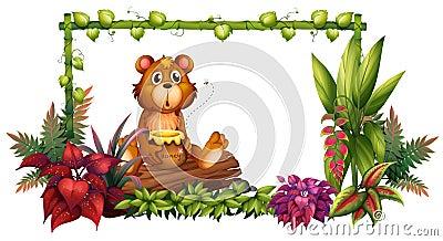 A bear above a trunk in the garden Stock Photo