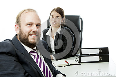 Beard business man brunette woman at desk smile