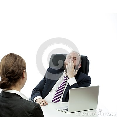 Beard business man brunette woman at desk yawn