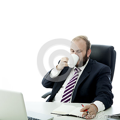 Beard business man drink coffee while working