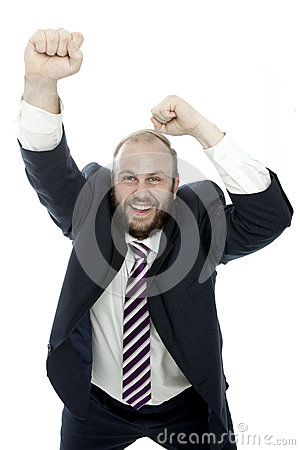 Beard business man wins with arms in the air