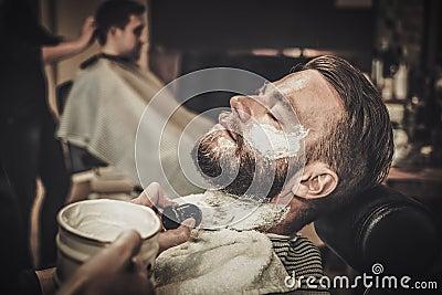 beard shaving in barber shop stock photo image 63883831. Black Bedroom Furniture Sets. Home Design Ideas