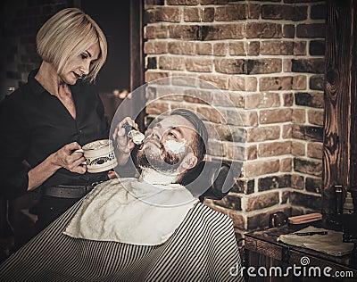 beard shaving in barber shop stock photo image 63883886. Black Bedroom Furniture Sets. Home Design Ideas