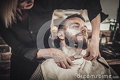 beard shaving in barber shop stock photo image 63883925. Black Bedroom Furniture Sets. Home Design Ideas