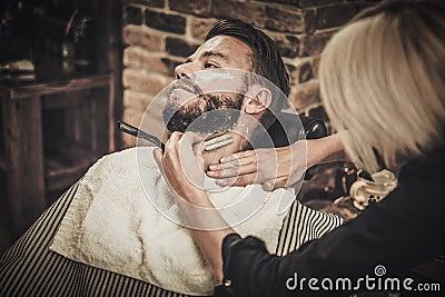 beard shaving in barber shop stock photo image 63883956. Black Bedroom Furniture Sets. Home Design Ideas