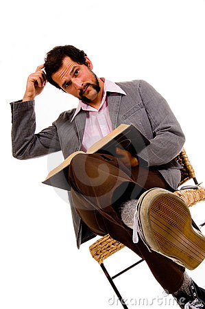 Bearded male student reading book  - expressing confusion