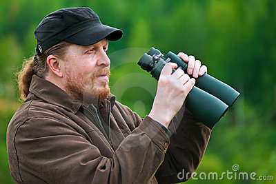 A bearded man with binoculars.