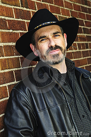 Bearded man in cowboy hat