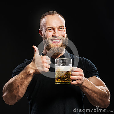 Free Bearded Man Drinking Beer From A Beer Mug Over Black Background. Royalty Free Stock Photo - 66852615