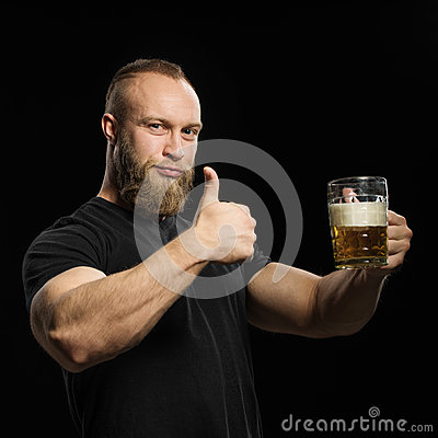 Free Bearded Man Drinking Beer From A Beer Mug Over Black Background. Royalty Free Stock Photo - 66852685