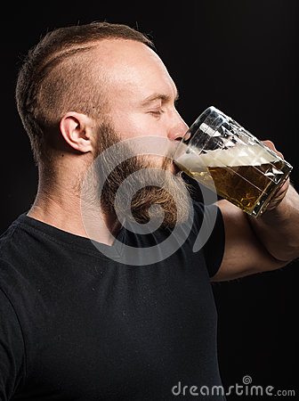 Free Bearded Man Drinking Beer From A Beer Mug Over Black Background. Stock Photo - 66852710