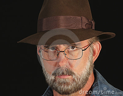 A Bearded Man in Glasses and a Fedora