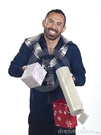 Bearded man holding a variety of wrapped gifts