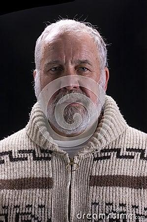 Bearded man over black