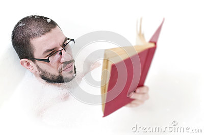 Bearded man reading in the bathtub
