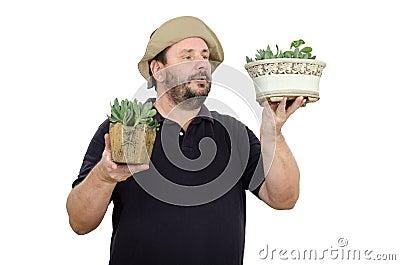 Bearded man is seller in flower shop