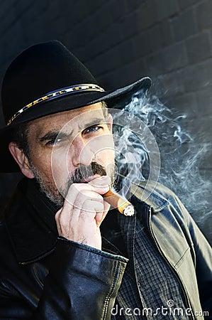 Bearded man smoking cigar