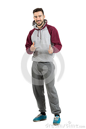 Free Bearded Smiling Young Man In Casual Sportswear Pointing Finger Gun Hand Gesture At Camera Stock Photos - 61952743
